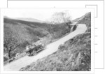 A Morris Oxford climbing a steep hill in the Lake District by Anonymous