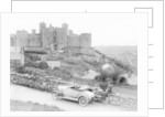 A Singer car in front of Harlech Castle by Anonymous