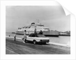 A 1974 Ford Capri on a quay, in front of a Townsend Thoresen car ferry by Anonymous