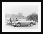 An Aston Martin DB2-4 MKII, with Windsor Castle in the background by Anonymous
