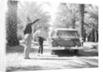 Couple with a 1955 Chevrolet Townsman station wagon by Anonymous