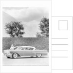 Woman with a 1957 Cadillac coupe de ville by Anonymous