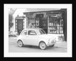 Fiat 500 parked outside a quaint shop, 1969 by Unknown