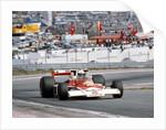 Jochen Mass racing a McLaren-Cosworth M23 by Anonymous