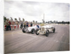 A 1914 and 1937 Grand Prix Mercedes racing cars at the starting line by Anonymous