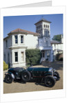 A 1930 Bentley Supercharged outside a house by Unknown