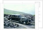 A 1937 Cadillac V16 sedan, photographed among piles of slate by Unknown
