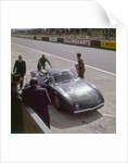 Jackie Stewart getting into a Rover BRM turbine by Anonymous