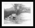 1935 Singer 1.5 Litre Le Mans taking part in a water splash trial by Anonymous