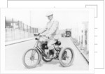 An 1898 De Dion tricycle and rider by Anonymous