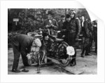 Karl Burlage having his Norton bike weighed for a TT competition by Unknown