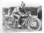A man dressed in leathers on a Harley-Davidson by Unknown