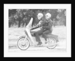 A man and a woman riding an Ariel Leader by Anonymous