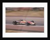 Graham Hill's Lotus at speed by Anonymous
