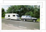 1995 Toyota Landcruiser towing large caravan at speed by Unknown