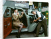Mechanic with lady driver doing her make up, 1930's Hillman Minx by Unknown