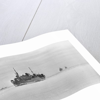 Merchant ships steaming through thin sea ice by unknown