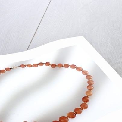 Amber beads by unknown