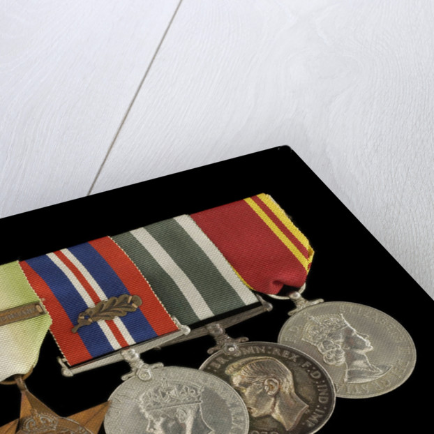Medals awarded to W. T. Elmslie DSM RNR (obverse, l to r, MED1643-1648) by P. Metcalfe
