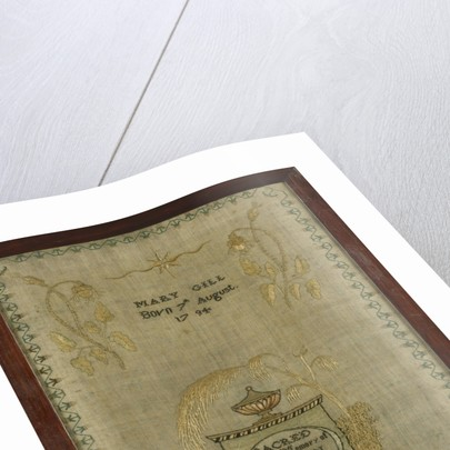 A mourning sampler framed in oak by Mary Gill