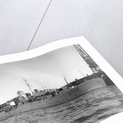 Photograph of starboard view just forward of the broadside of HMS 'Rhododendron' (1940) dated pre October 1942 alongside quay. Pendant K78. by unknown