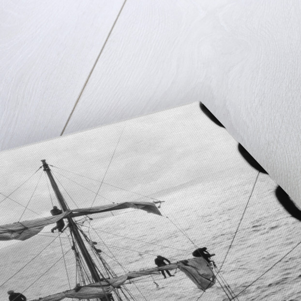 Aloft on the Mizzen furling the blown-out sails by Alan Villiers