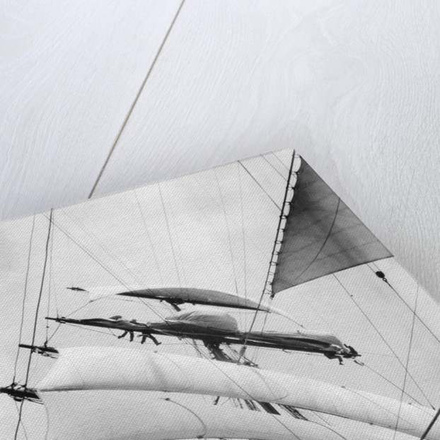 High aloft, taking in sail as the storm increases by Alan Villiers