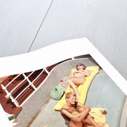Passengers sunbathe aboard an unspecified cruise liner by Marine Photo Service