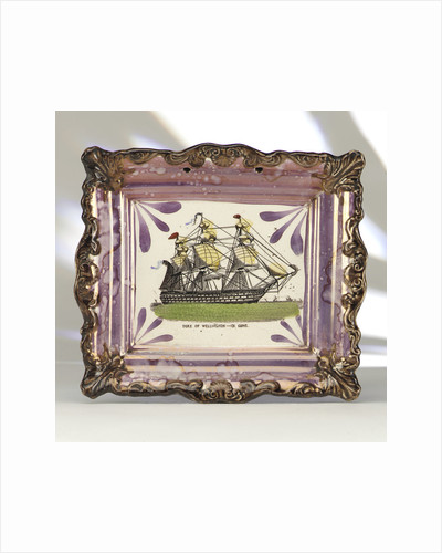 Purple lustre wall plaque by unknown