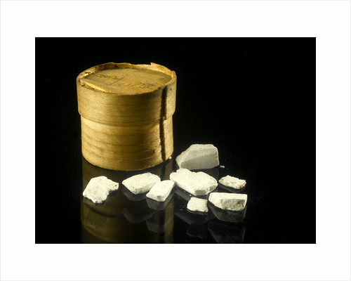 Pill box containing eight chalky white plaster-like crystals by unknown