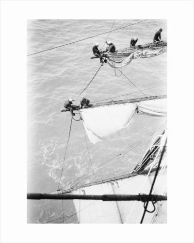 Changing the lower and upper topsails on the starboard yardarms by Alan Villiers