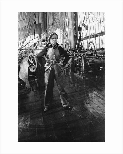 Elisabeth Jacobsen on deck, in oilskins, aboard 4 masted barque 'Parma' (Fi, 1902), ex 'Arrow' (Ruben de Cloux) by Alan Villiers