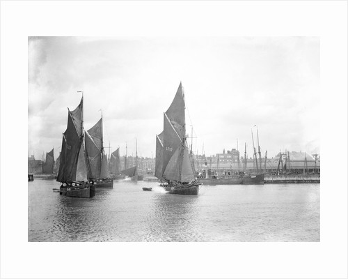 The sailing trawlers 'LT325', 'LT653' and 'LT37' leaving the outer harbour at Lowestoft, Suffolk, taken from the end of the breakwater by Smiths Suitall Ltd.