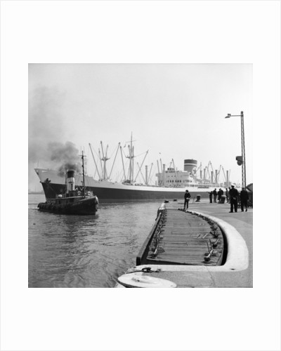 The Blue Star Line's 'Auckland Star'entering the King George V Dock in April 1964, assisted by the tug 'Atlantic Cock'. The 'Auckland Star' remained in service until 1978. by Grierson Collection
