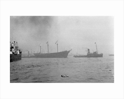 The clipper ship 'Cutty Sark' (1869) being towed from the East India Dock to Greenwich by the tug 'Gondia' (1927) by unknown