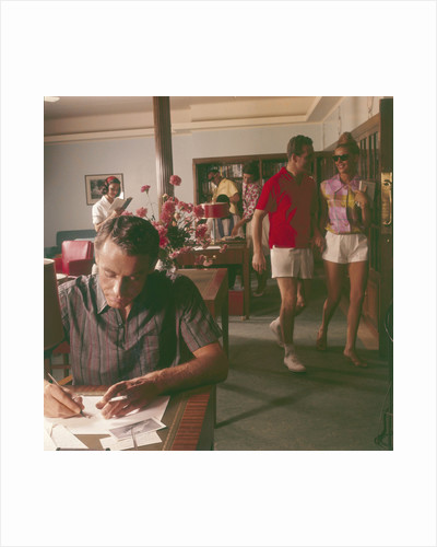 Passengers on board an unspecified cruiser liner pass the time by writing and walking the ship by Marine Photo Service
