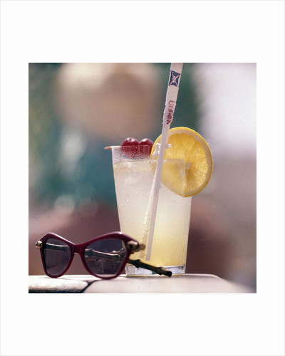 Cocktail and sunglasses aboard a Union-Castle cruise liner by Marine Photo Service