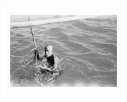 A Kuwaiti pearl diver draws breath between dives by Alan Villiers