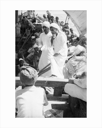 Nejdi and the mate, Hamed bin Salim, check passengers from Hadramuaut crowded on board the 'Triumph' by Alan Villiers