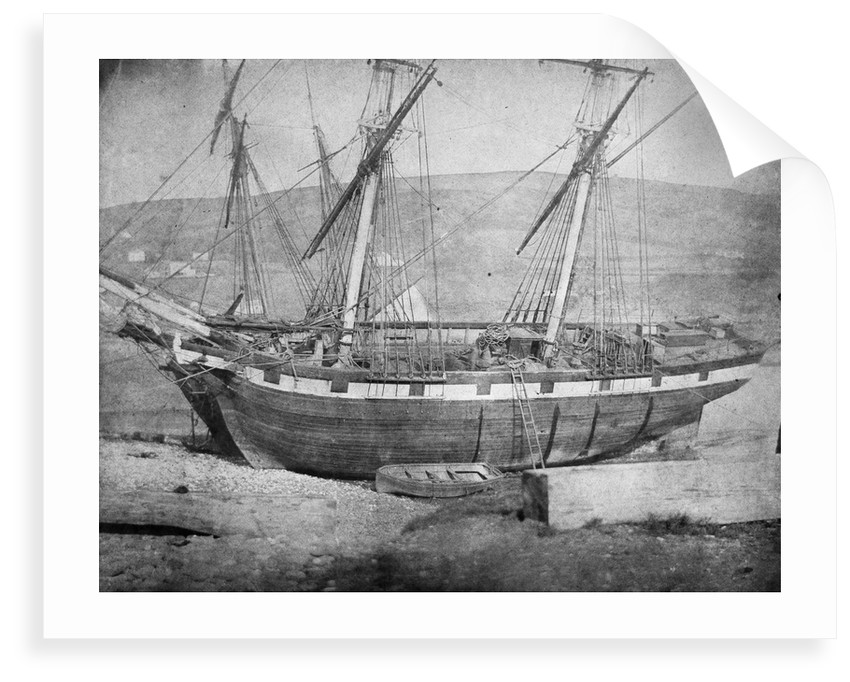 Broadside view of two unidentified vessels at low tide by unknown