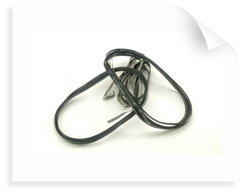 Four strips of magnesium ribbon in a bag by unknown