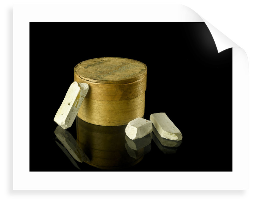 Pill box containing eight chalky plaster like crystals by unknown