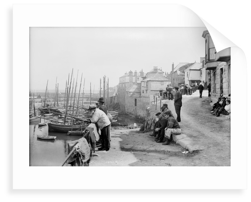 Newlyn Harbour, Cornwall. The old harbour with fishermen looking out to sea. by National Maritime Museum