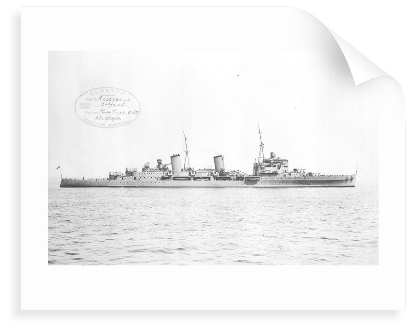 HMS 'Belfast' (1938) topped at Spithead with all guns trained to starboard by unknown
