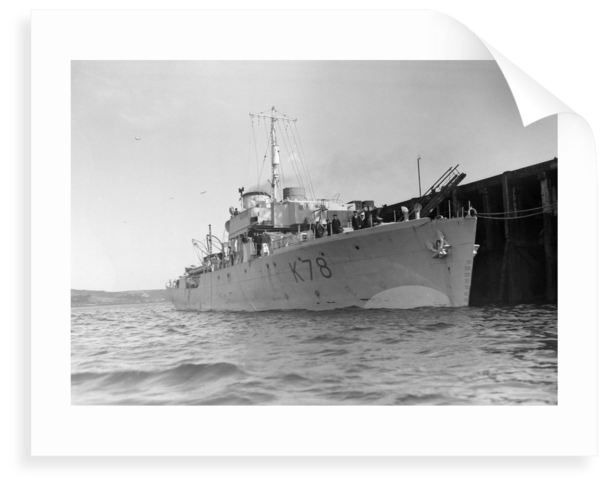 Photograph of starboard bow view of HMS 'Rhododendron' (1940) dated pre October 1942 alongside quay. Pendant K78. by unknown