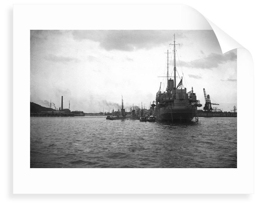 HMS 'Titania' (1915) submarine depot ship, moored at Portland with 4 submarines alongside by unknown