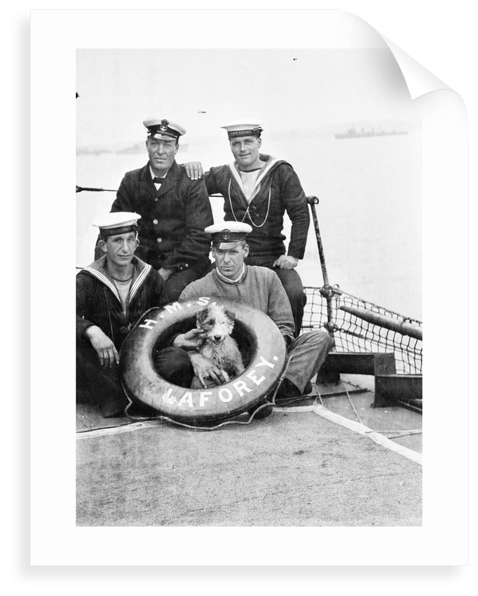 Photograph of four petty officers on board 'Laforey' (1913) at Harwich in 1915-1916 with the ship's dog mascot by unknown