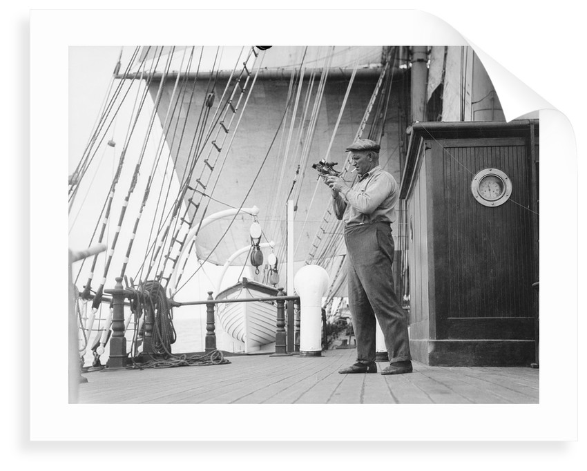 Captain Ruben de Cloux examining the reading on his sextant by Alan Villiers