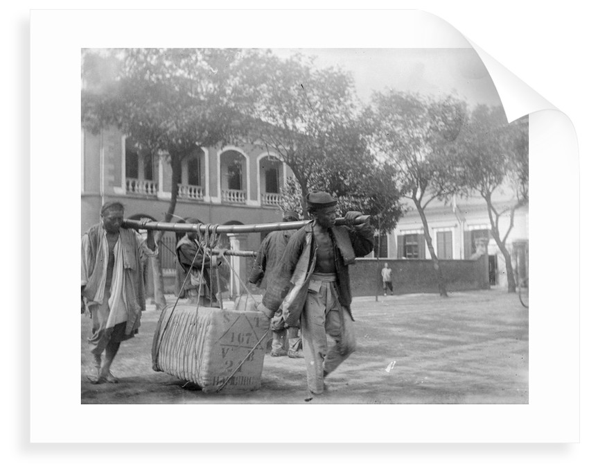 Two Chinese men carrying a load suspended from a pole between them by Kenneth Hurlstone Jones