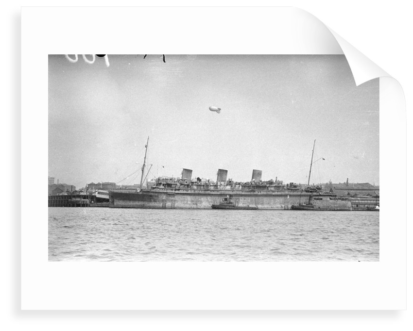 'Monarch of Bermuda' (1931) alongside in the River Mersey in 1942-1943, probably refitting as a mercantile LSI(L) by unknown